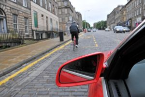 Cyclist on George Street, Edinburgh